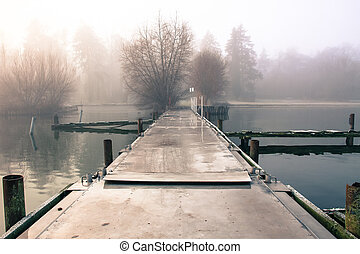 lake bank - a lake on a foggy autumn morning