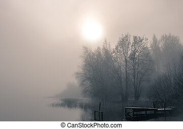 lake bank - a lake on a foggy autumn morning
