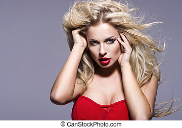 Portrait of beautiful blonde woman with red lips and curly hairs