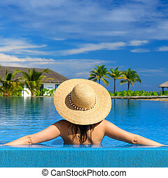 Woman at poolside - Woman in hat at the pool