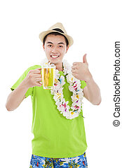 happy young man drinking beer at summer time