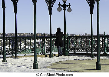 Man reflecting at an overlook observation deck