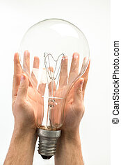 Man holding big light bulb in his hands on white background