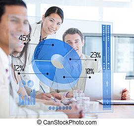 Business people using blue pie chart futuristic interface