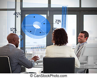 Smiling business people using blue pie chart on futuristic...