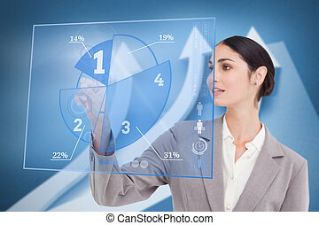 Smiling businesswoman using blue pie chart interface