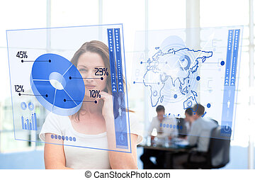 Smiling businesswoman looking at blue pie chart interface...