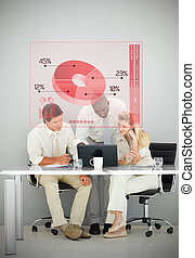 Three business people using red pie chart interface while...