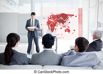 Business people listening and looking at red map diagram...