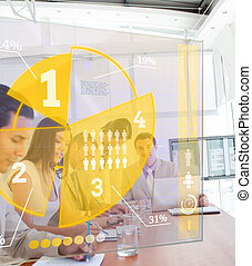 Group of colleagues using yellow pie chart interface in a...