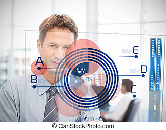 Businessman looking at blue diagram interface