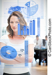 Confident businesswoman using chart interfaces with...