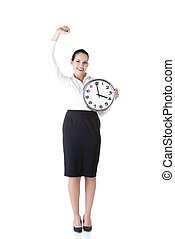 Happy young business woman holding office clock