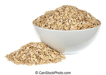 Rolled oats in a white ceramic plate over white background
