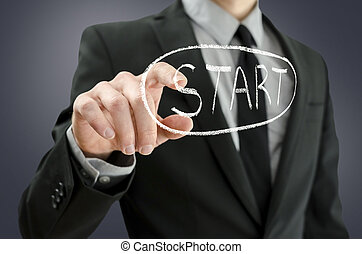 Business man pressing start button on a virtual board.