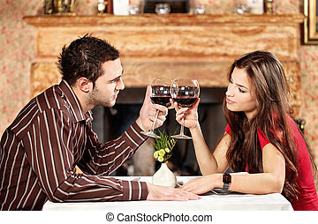 Couple cheers with wine