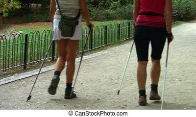 Nordic walking - active women exercising outdoor