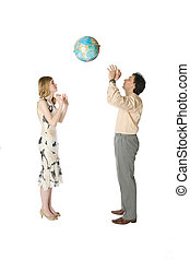 Playing with Earth - Man and woman playing with a big globe