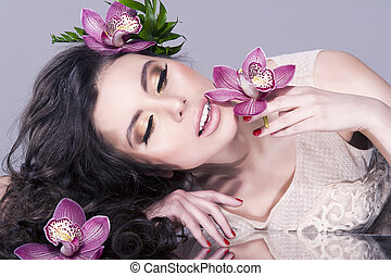 Beauty Girl With  Flowers .Beautiful Model Woman Face