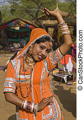 Dancer in Orange - Kalbelia dancer from the Jaipur area of...
