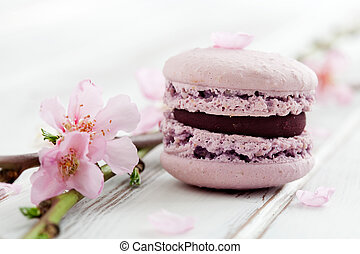 French macaroons in pink, decorated with cherry blossom