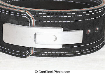 Belt for powerlifting. - A belt of black suede with a rifle,...