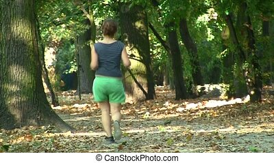 Young woman runs in public park
