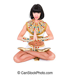 Yoga woman wearing a egyptian costume Isolated on white...