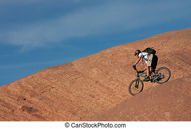 Another Slickrock Rider - A mountain biker riding the edge...