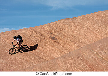 Exit - A mountain biker about to exit the frame on Moab\\\'s...