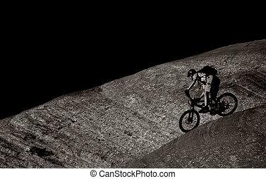 Another Slickrock Rider - A black and white photo of a...