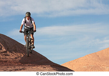 Biking Slickrock - A smiling rider on Moab\\\'s famous...