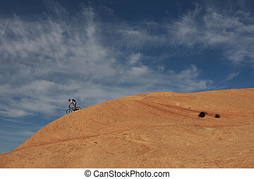 Another Slickrock Descent - A lone rider on Moab\\\'s famous...
