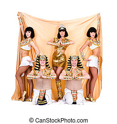 dancers dressed in Egyptian costumes posing