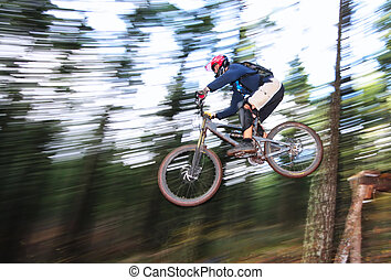 Blurred Leap - A skilled mountin biker leaps off of a jump...