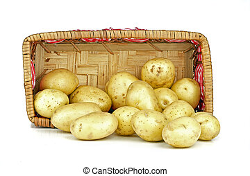 New potatoes falling out of a basket