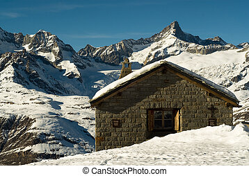 mountain hut in winter, zermatt, switzerland