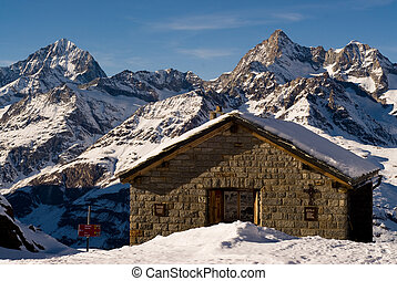 mountain hut in winter, zermatt, switzerland.