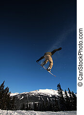 Airtime - A snowboarder in flight on Whistler Mountain, BC