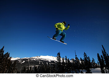 Airtime - A snowboarder takes flight on Whistler Mountain