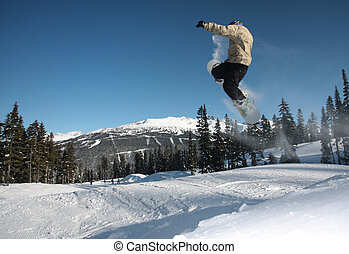 Flight - A snowboarder flies through the air in Whistler,...