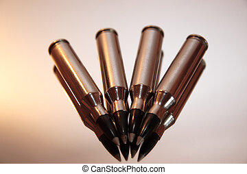 ammo - ammunition all in a row on a silver background