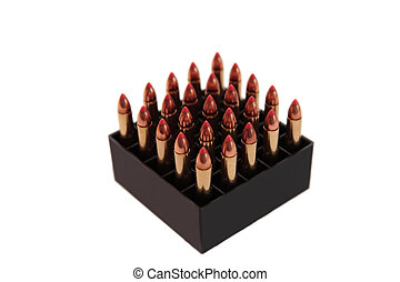 ammo - ammunition all organized in a box on a white...