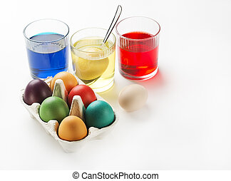 Eggs dyeing - Easter eggs dyeing in glass with colors