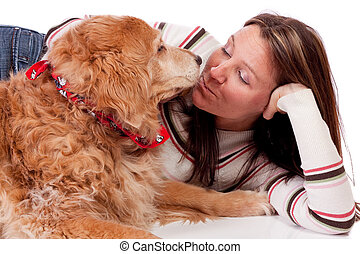 Young woman and golden retriever
