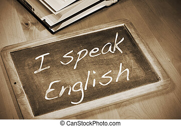 sentence I speak english written with chalk on a blackboard,...