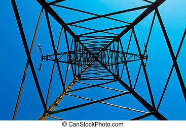 Pylon & power lines against blue sky