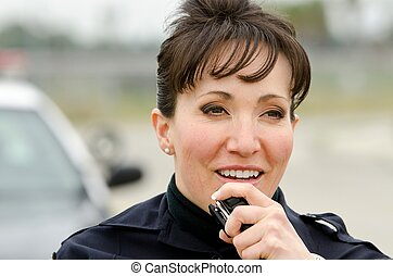 Police radio - a female police officer talks on the radio...