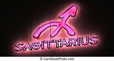 Pink Sagittarius Zodiac sign in glowing pink neon light with...