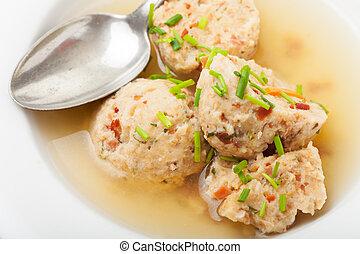 speckknoedel, a tyrolean dumpling in broth